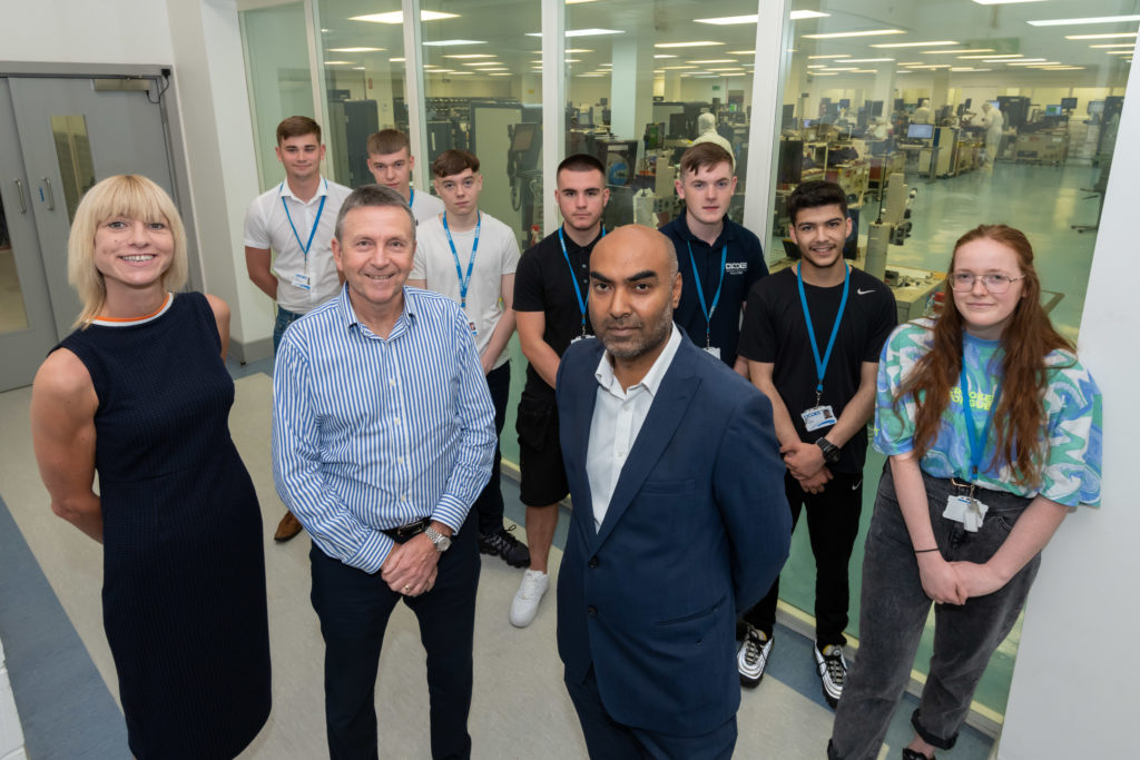 Upturn 's Maria Williams and Anwar Ali at Diodes Zetex with Dave Benstead and apprentices